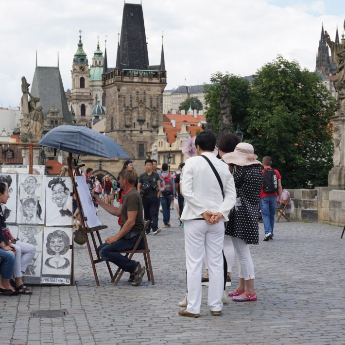 busy-charles-bridge-in-prague-cz-group-of-tourists-in-europe_t20_jRjVda