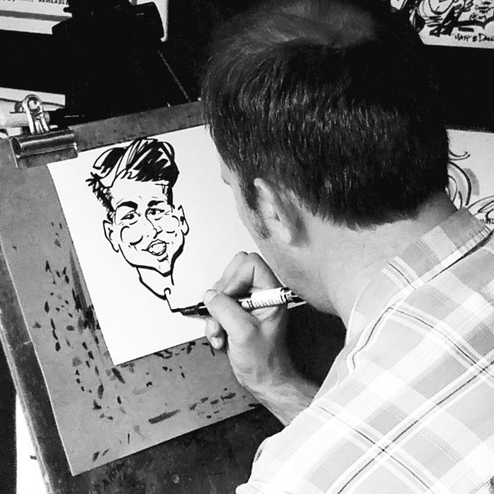 vertical-monochromatic-image-of-caricaturist-drawing_t20_AewzOm